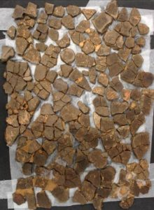 Laying out the pottery sherds before reconstruction.