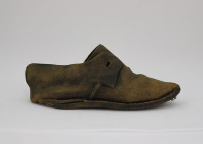 Shipwreck child's shoe during conservation