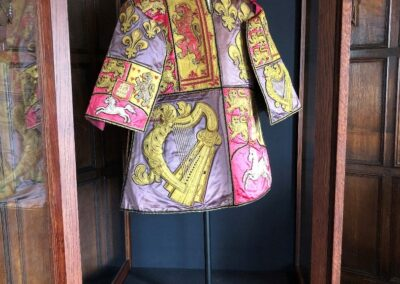 The tabard in the display case.
